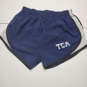 TCA Sport Trek sm purple with white & black shorts